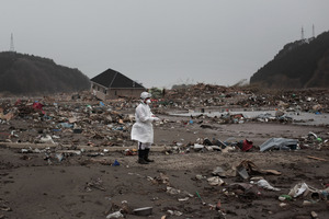 Search teams sift through rubble in Rikuzentakata, Japan. Photo / Getty Images