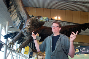 Richard Taylor with one of the giant great eagles created by Weta Workshop and installed at Wellington International Airport. Photo / Mark Mitchell