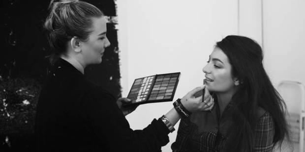 M.A.C makeup artist Amber D, photographed here at a magazine shoot with Lorde, has been travelling with the singer, working on her signature look. Photo / Olivia Hemus