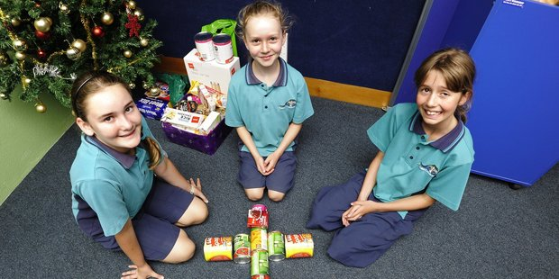 St Thomas More Catholic School Young Vinnies Sophia Wilson, Melissa Kuipers and  Ellen Cook helped organise a collection for the foodbank. Photo/George Novak.