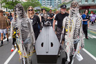 The protest group carries its coffin along Lambton Quay to Parliament yesterday. Photo / Mark Mitchell
