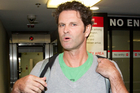 Chris Cairns arrives at the Auckland Domestic Airport. Photo / Richard Robinson