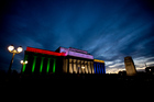 The Auckland War Memorial Museum lit in the colours of the South African flag as a tribute to Nelson Mandela. Photo / Dean Purcell.
