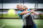 Justin Mackenzie gives Rachel Grunwell some tennis tips. Photo / Michael Craig
