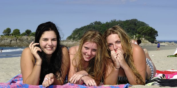 Amber Prior,18, Shannon Slegh, 18, and Laura Wright, 18, enjoy the sunshine at Mount Main Beach.
