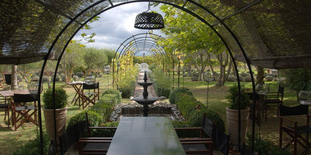 The garden and outdoor dining area at Hans Herzog. Photo / Alexia Santamaria