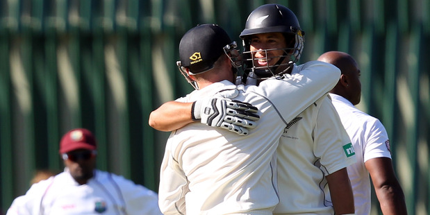 Ross Taylor and Brendon McCullum  congratulate each other after both scored centuries yesterday. Photo / Getty Images