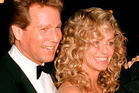 Ryan O'Neal with Farrah Fawcett.