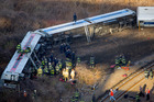 First responders work the scene of a derailment of a Metro-North passenger train in the Bronx. Photo / AP