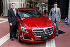 Sumito Ishii, managing director of General Motors Japan, right, and Gregg Sedewitz, director of sales and marketing, pose with a new Cadillac CTS during a press conference in Tokyo. Photo / AP