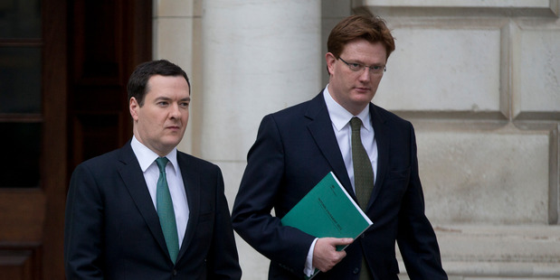 Britain's Chancellor of the Exchequer George Osborne, left, and his deputy the Chief Secretary to the Treasury Danny Alexander, leave the Treasury. Photo / AP