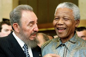Cuban leader Fidel Castro, left, shares a laugh with South Africa President Nelson Mandela. Photo /AP