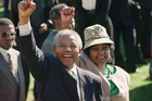 Newly-elected African National Congress President Nelson Mandela and his wife, Winnie, greet the crowd after arriving at a rally. Photo / AP