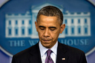 President Barack Obama pauses as he speaks in the briefing room of the White House in Washington. Photo / AP