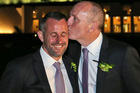 Western Australian politician Stephen Dawson, right, gives his husband Dennis Liddelow a kiss after they married in front of Parliament House. Photo / AP