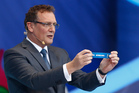 FIFA Secretary General Jerome Valcke holds the ticket of the Netherlands during the draw ceremony for the 2014 soccer World Cup in Costa do Sauipe near Salvador, Brazil. Photo / AP