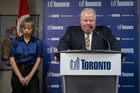 Toronto Mayor Rob Ford stands with his wife, Renata, at a news conference in Toronto. Photo / AP