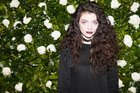 Lorde performed at the MOMA Film Benefit Presented by Chanel in New York. Her makeup, by M.A.C's Amber D, included her signature dark lip using M.A.C 'Cyber' lipstick. Photo / Supplied by Chanel