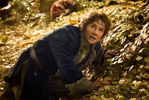 MARTIN FREEMAN as Bilbo Baggins upon Smaug's pile of gold.