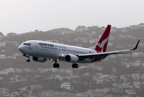A Qantas aeroplane landing at Wellington airport photo/NZ Herald