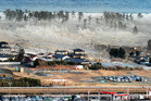 A tsunami hit came as a result after a powerful earthquake in Natori, Miyagi prefecture, Japan. Photo / AP