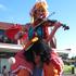 Circus Kumarani fiddler Anais Jo on the shoulders on Timo the juggler.  Photo / Peter de Graaf
