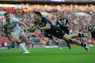 Shaun Johnson scores for the Kiwis in their rugby league World Cup semi-final against England. Photo / Getty Images.