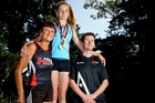 Georgia Hulls, centre, with her Nanny Jean Hulls, left, and father and coach Dean Hulls before another training run in the buildup to this weekend's national secondary schools athletics championships in Auckland. Photo/Glenn Taylor.