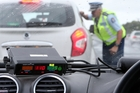 Inspector Murray Hodson talks to a driver nabbed travelling in excess of the 4km/h tolerance and doing 110km/h on State Highway 1. Photo/Michael Cunningham