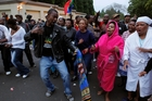 A group of mourners sing and dance outside Nelson Mandela's Johannesburg home. Photo / AP