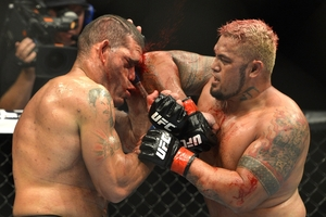 Mark Hunt hits Antonio 'Bigfoot' Silva with an elbow. Photo / Getty Images