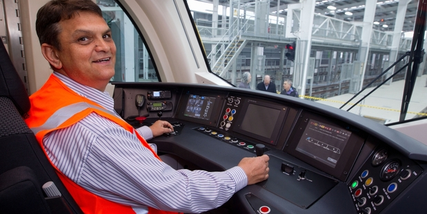 Driver William Els tries out the console of the new electric trains. Photo / Richard Robinson