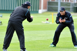 Kane Williamson catches throws from coach Mike Hesson at University Oval in Dunedin yesterday. Photo / ODT