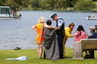LAKE TRAGEDY: Rotorua police and Lake Tarawera residents comfort family members of a man and his daughter who drowned when their kayak capsized out from the Bayview Road boat ramp yesterday morning. PHOTO/STEPHEN PARKER 011213SP16