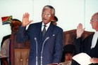 Nelson Mandela taking the oath on 10 May 1994 during his inauguration at the Union Building in Pretoria. Photo / AFP