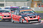 Greg Murphy leads  Scott McLaughlin. Photo / Andrew Bright