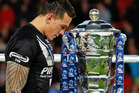 Sonny Bill Williams walks past the rugby league World Cup trophy. Photo / Getty Images