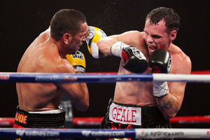 Daniel Geale (R) lands a right on Anthony Mundine (L) during the IBF Middleweight Title bout.  Photo / Getty Images