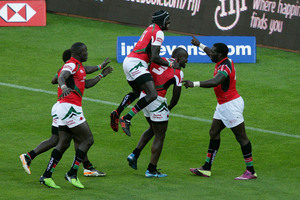 Willy Ambaka (R) of Kenya is congratulated on his winning try. Photo / Getty Images