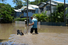 Floodwaters are seen in Torwood street, in the inner city suburb of Rosalie in Brisbane following ex-cyclone Oswald. Photo / AAP
