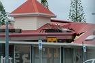 A passenger train sits crashed into the station building at the Cleveland Railway Station in Brisbane. Photo / AAP
