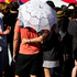 Fans shelter from the sun during Laneway Festival. Photo / Sarah Ivey