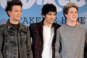 An Australian waitress claims she slept with One Direction singer Zayn Malik, centre. Photo / AP