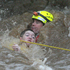 A Swift Water Rescue officer saves a young boy from a raging river in Queensland - the officer was then himself, swept down river following the rescue and was later saved. Photo / APN