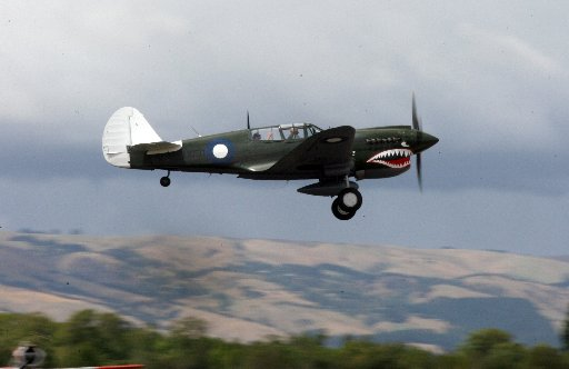Wings over Wairarapa - the P40 Kittyhawk leaves Hood Aerodrome in Masterton in formation with a Mosquito and two-seater Spitfire to do a flyover of the Wellington CBD.