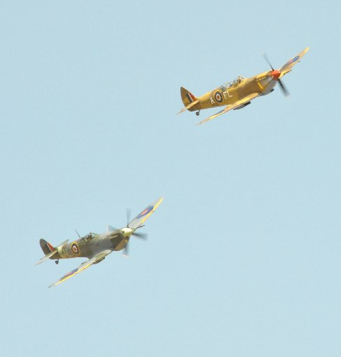 Wings Over Wairarapa Airshow, Hood Aerodrome Masterton, Saturday, two Mark 1X Spitfires roar across the airfield.