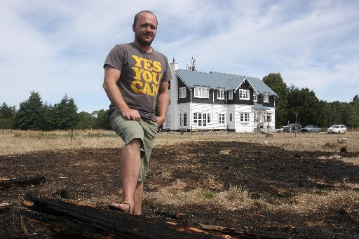 Fire in 40 gallon drum spreads threatening homes, a wooshed and the c1890 Sacred Heart Church on Te Ore Ore Road, Masterton. Pictured neighbour Andreas Laubscher stands where the fire raced onto his property.