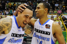 Leon Henry (L) and Mika Vukona of the Breakers celebrate after winning the round 14 NBL match between the Townsville Crocodiles and the New Zealand Breakers. Photo /Getty Images. 