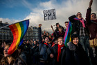 People demonstrate for the government project to legalise same-sex marriage and adoption for same-sex couples in Paris. Photo / AP