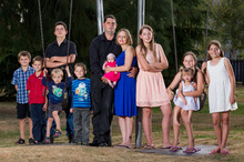 Craig and Melanie Jackson with their 10 children, who range in age from six weeks to 16 years.Photo / Stephen Barker